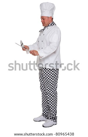 Photo of a chef in white uniform sharpening a knife isolated on a white background.