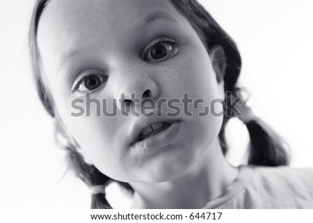 Photo of a child looking into camera.