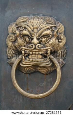 Photo of a Chinese Door With Door Knocker,This is on a city front door knocker. - stock photo