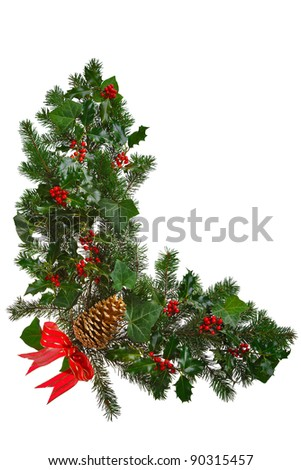 Photo of a Christmas garland in an L shape with holly, red berries, ivy, spruce, pine cone and a red bow. Isolated on a white background. - stock photo