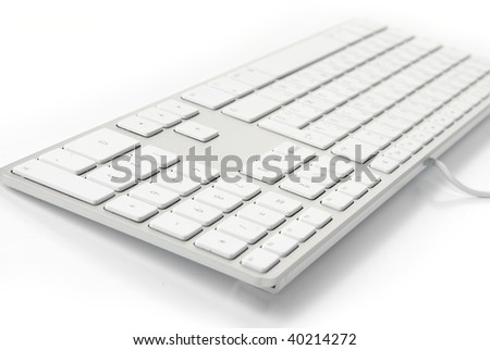 photo of a close up on a modern white keyboard - stock photo