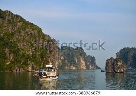 Photo of a cruise sailing over the Halong Bay water. Halong Bay is located in Vietnam and being labeled as one of the wonder of the world