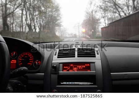 Photo of a dashboard in a foggy morning - stock photo