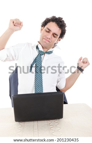 Photo of a desperate caucasian business man frustrated with work sitting in front of a laptop with his hands up, stretch up. Stiffness, back pain and neck pain because overtime at work - stock photo