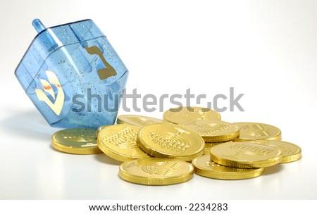 Photo of a Dreidel and Gelt (Candy Coins) - Chanukah Related Objects - stock photo