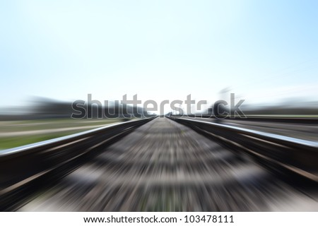 Photo of a Fast train in motion and blue sky - stock photo
