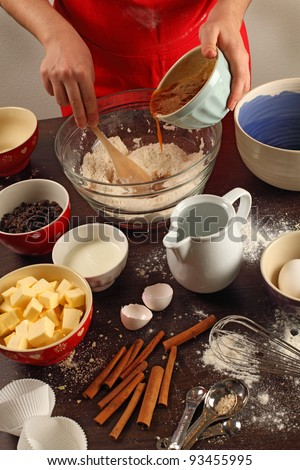 Photo of a female mixing ingredients in a large glass bowl. - stock photo