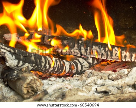 photo of a fire burning in a grill