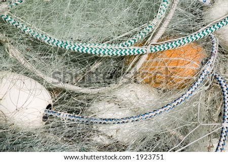 Photo of a fishing net with white floats. - stock photo