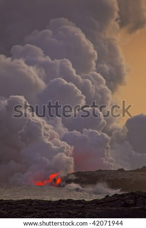 photo of a flowing lava into the ocean - stock photo