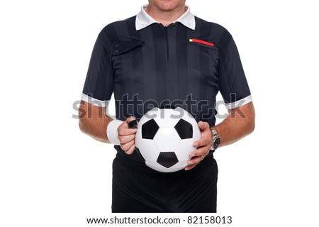 Photo of a football or soccer referee holding a ball and whistle, red and yellow cards in his pocket, isolated on a white background. - stock photo