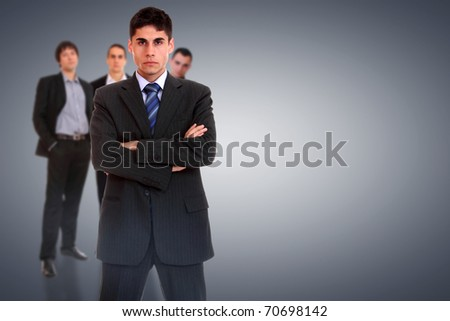 Photo of a four person business team isolated on a white background - stock photo