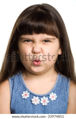 Photo of a girl grimacing, isolated on white - stock photo