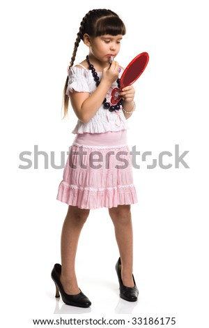 Photo of a girl with lipstick, playing adult - stock photo