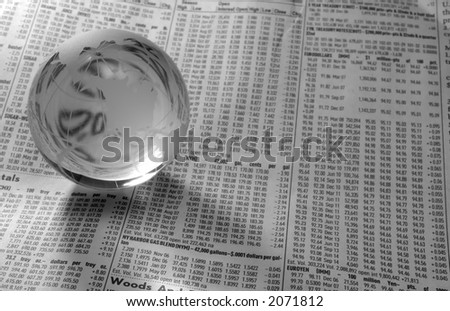 Photo of a Glass Globe on a FInancial Newspaper - Black and White - stock photo