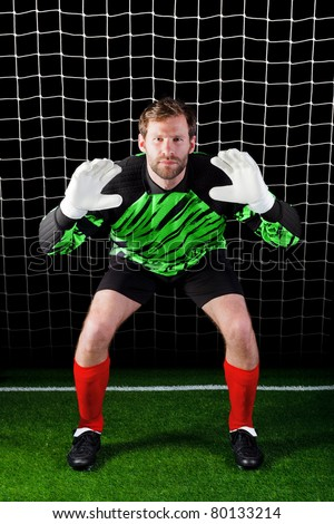 Photo of a goalkeeper facing a penalty kick, good image for concepts like Savings or Security as well as football related themes. - stock photo