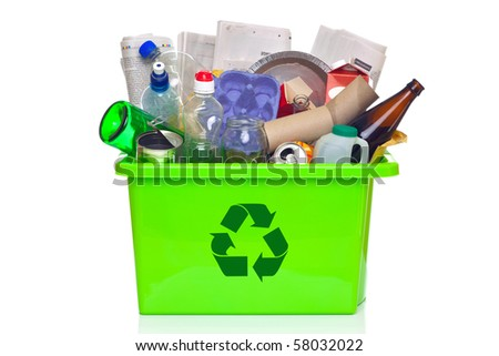 Photo of a green recycling bin full of recyclable items isolated on a white background. - stock photo