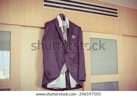 Photo of a groom's suite and tie, isolated - stock photo