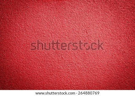 Photo of a grunge red metallic paint textured background
