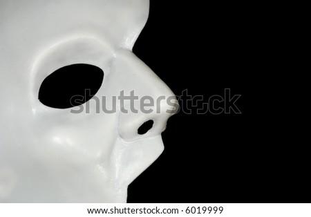 Photo of a Half WHite Mask - Phantom of the Opera - Background - stock photo