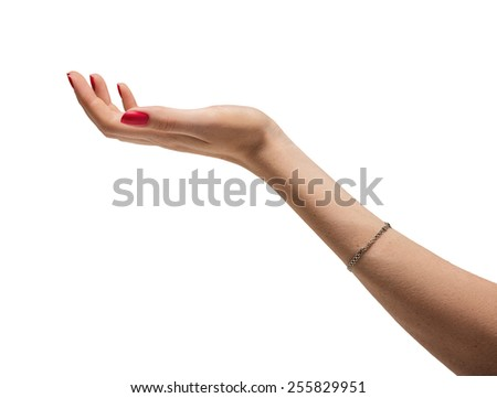 Photo of a hand of a woman with red manicure and bracelet - stock photo