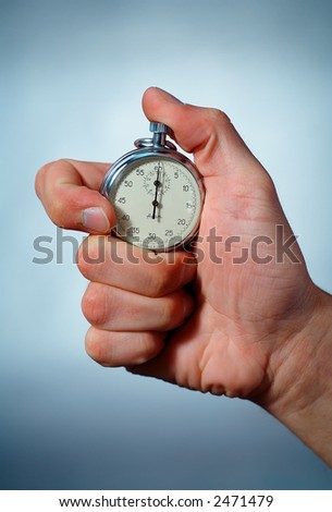 Photo of a Hand with a Stopwatch - stock photo