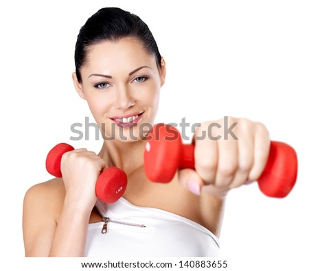 Photo of a healthy training young woman with dumbbells.  Healthy lifestyle concept. - stock photo