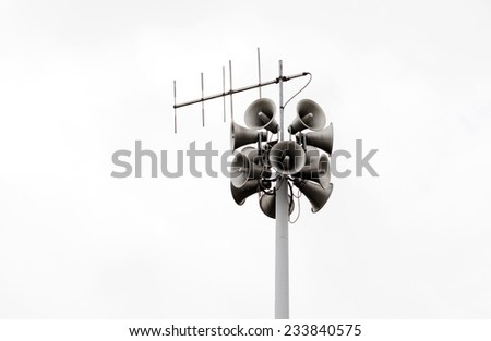 Photo of a high pylon speaker in the military  - stock photo