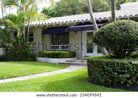 Photo of a home with hedges and bushes - stock photo