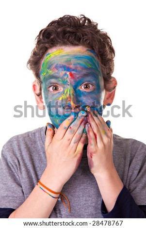 Photo of a kid having fun with painted face. Isolated on white background. - stock photo