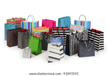 Photo of a large group of colourful shopping bags. Clipping path included. Shadows visible. - stock photo