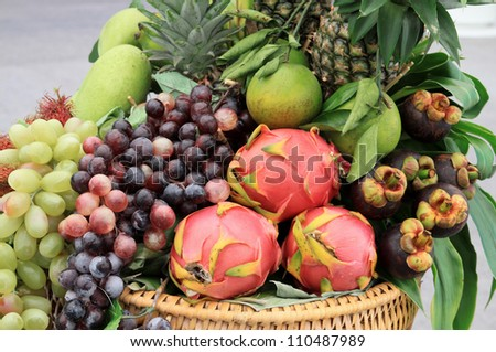 Photo of a large group of fruit and vegetables in basket - stock photo