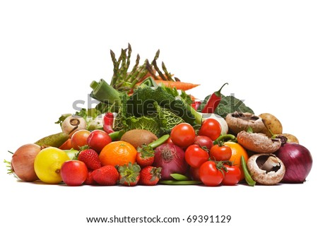Photo of a large group of fruit and vegetables isolated on a white background. - stock photo