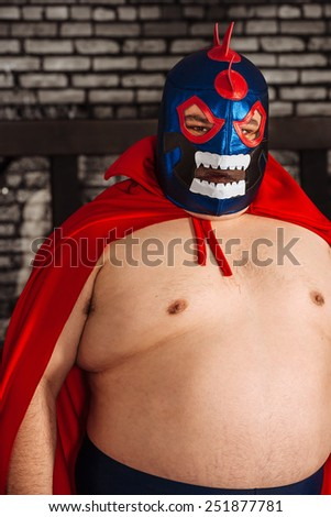 Photo of a large Mexican wrestler or Luchador posing. - stock photo