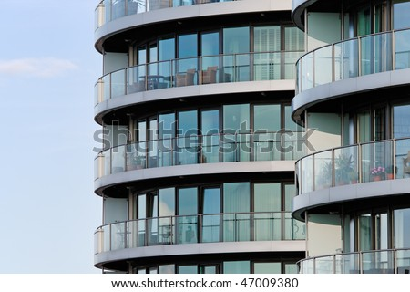 Photo of a luxury apartment building in London against a blue sky - stock photo