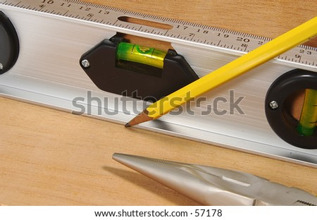 Photo of a Lvel, Pencil and Pliers