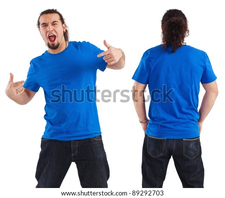 Photo of a male in his early thirties pointing at his blank blue shirt.  Front and back views ready for your artwork or designs. - stock photo
