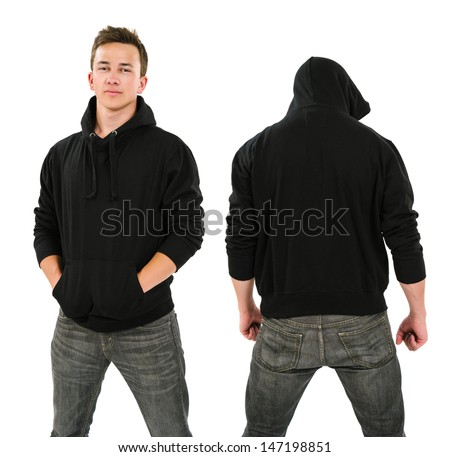 Photo of a male in his late teens posing with a blank black hoodie.  Front and back views ready for your artwork or designs.  - stock photo