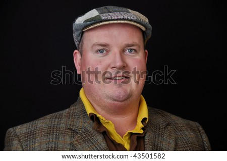 photo of a male in his 30's overweight on black background - stock photo