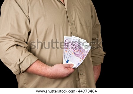 photo of a male person with 500 euro in cash on black - stock photo