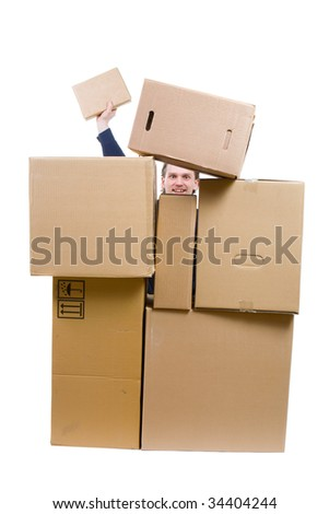photo of a man heap up with many boxes only head and hand are visible