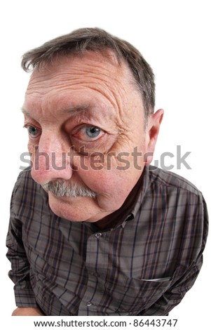 Photo of a man in his sixties using a fisheye lens to exaggerate his features. - stock photo