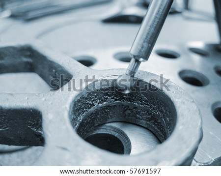 photo of a man inspecting steel part - stock photo