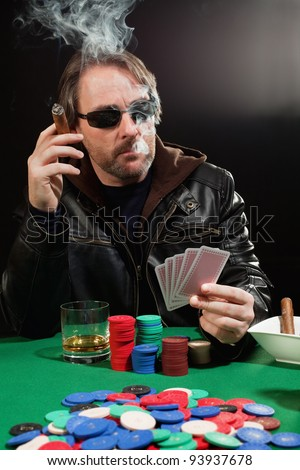 Photo of a man playing poker and smoking a cigar. Playing cards have been altered to be generic.