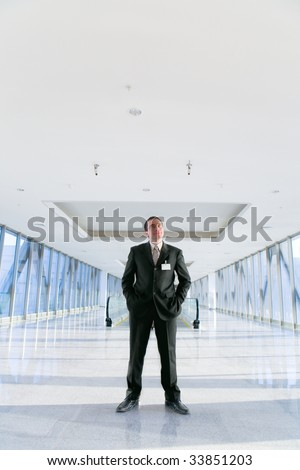 photo of a man standing in the hall