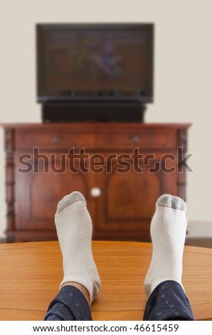 photo of a man watching TV - stock photo