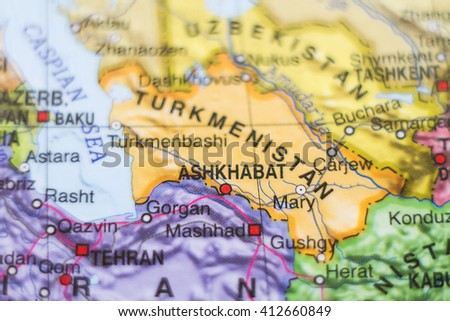 Photo of a map of Turkmenistan and the capital Ashkhabad . - stock photo