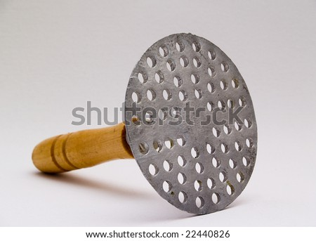 photo of a masher on a white background - stock photo