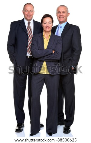 Photo of a mature business team consisting of two businessmen and a businesswoman, full length and isolated on a white background.