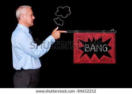 Photo of a mature businessman against a black background being delivered a knockout punch by a handrawn chalk boxing glove on expanding mechanical arm. - stock photo